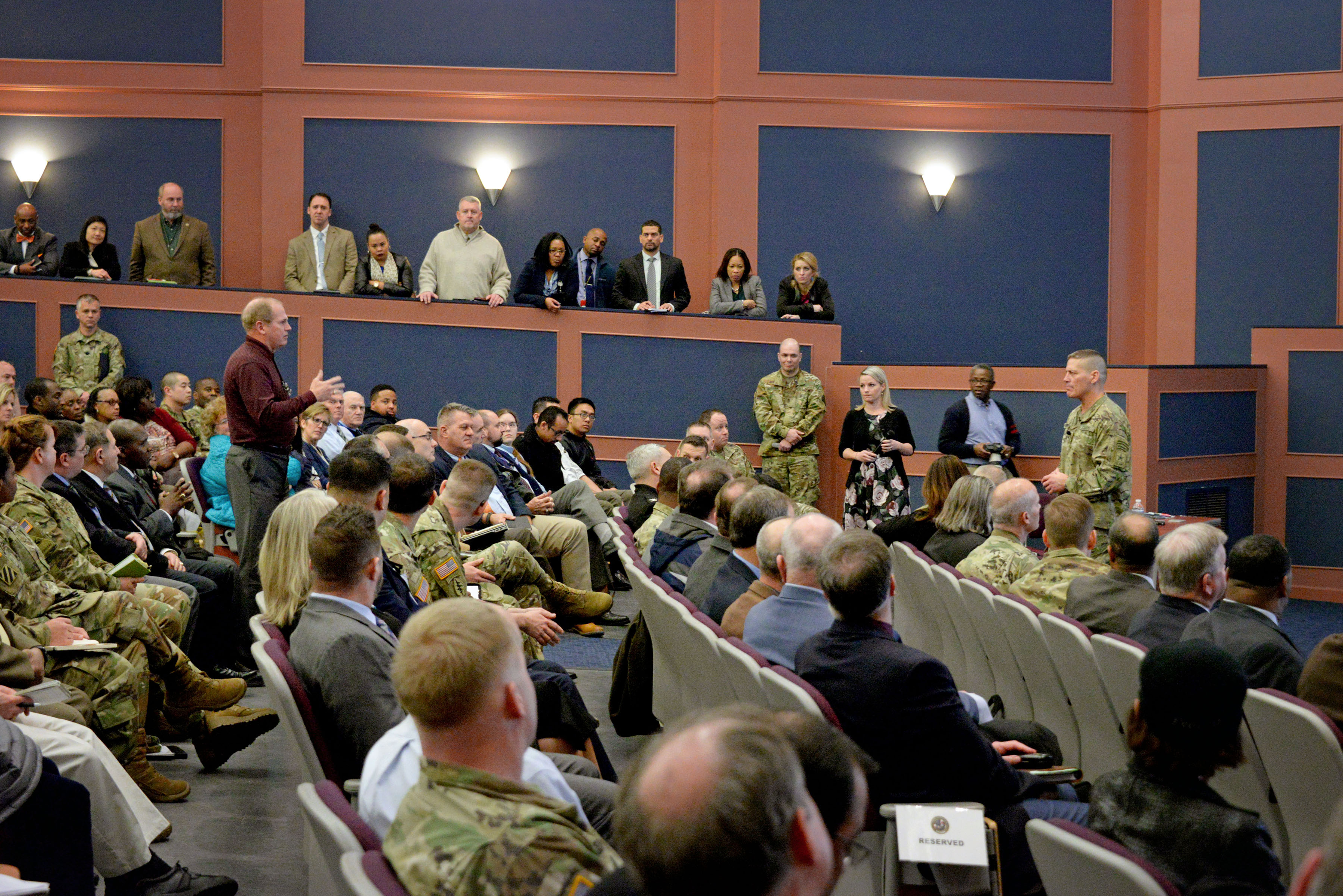 PEO Soldier's Jeff Witherel asks a question during the meeting, during which Ostrowski detailed a multipoint plan that creates an ACAT IV, delegates MDA of ACAT III and ACAT IV programs and expands the use of SAMPs.