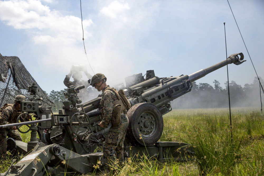Marines load another round into their M777 Howitzer during a fire mission to engage simulated enemy targets at Camp Lejeune, N.C., May 16, 2017. The Marines are participating in Burmese Chase, an annual, multi-lateral training exercise between U.S. armed forces and NATO members. The Marines are with 2nd Battalion, 10th Marine Regiment. (U.S. Marine Corps photo by Pfc. Taylor W. Cooper) (Photo Credit: U.S. Army)