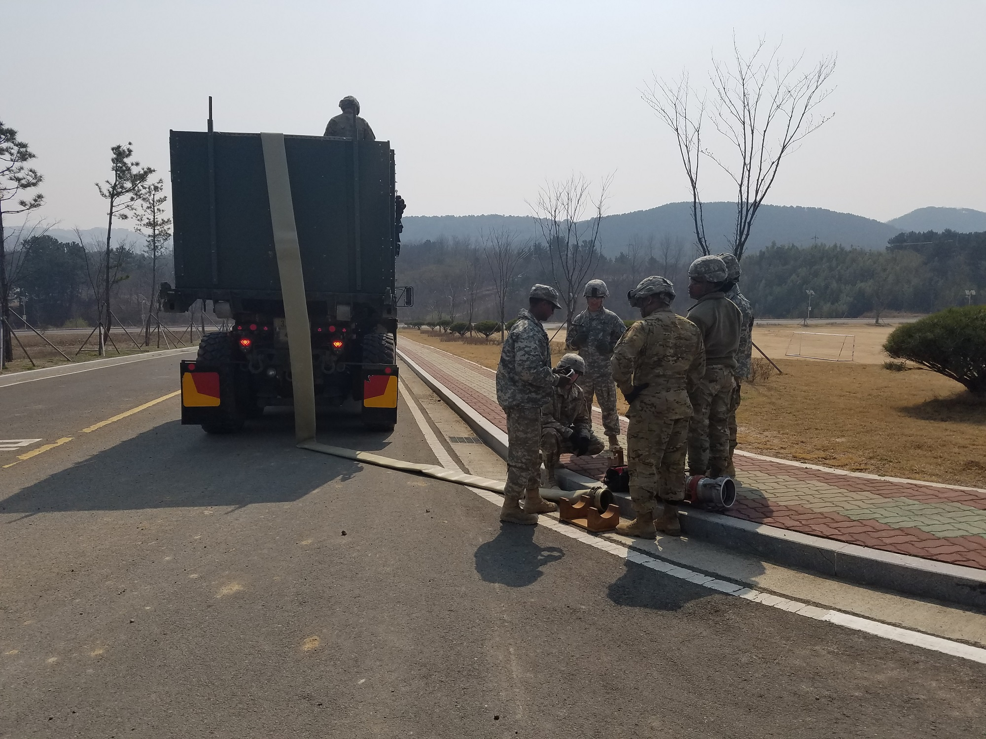 Soldiers from the 339th Quartermaster Company and the 498th Combat Service Support Battalion used existing culverts to thread 9,500 feet of lay-flat hose though pipes during the Combined Joint Logistics Over-the-Shore exercise at Pohang, South Korea, last spring. The hose is part of the Fight Tonight Emergency Fuel Distribution System, which can deliver 720,000 gallons of fuel per day. (U.S. Army photo by Drew Downing, RDECOM)