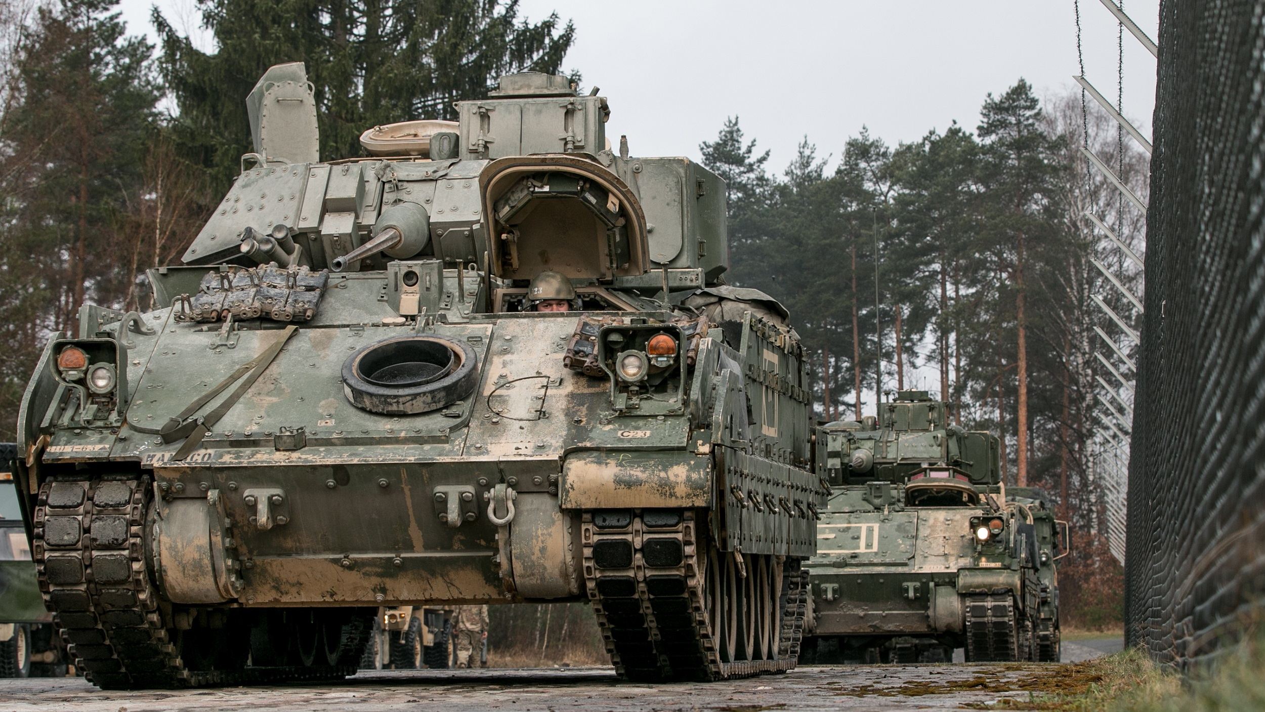 M2 Bradley fighting vehicles are lined up in Grafenwoehr, Germany to be fitted with Multiple Integrated Laser Engagement System (MILES) gear on April 11, 2018, in preparation for a field exercise during Combined Resolve X. Exercise Combined Resolve X is an U.S. Army Europe exercise series held twice a year in the major training areas of southeastern Germany, with this iteration scheduled to take place in April 2018. The Joint Warfighting Assessment leveraged Combined Resolve X, along with the Air Force's Blue Flag, that were also occurring in Europe. (U.S. Army photo by Spc. Dustin D. Biven / 22nd Mobile Public Affairs Detachment)