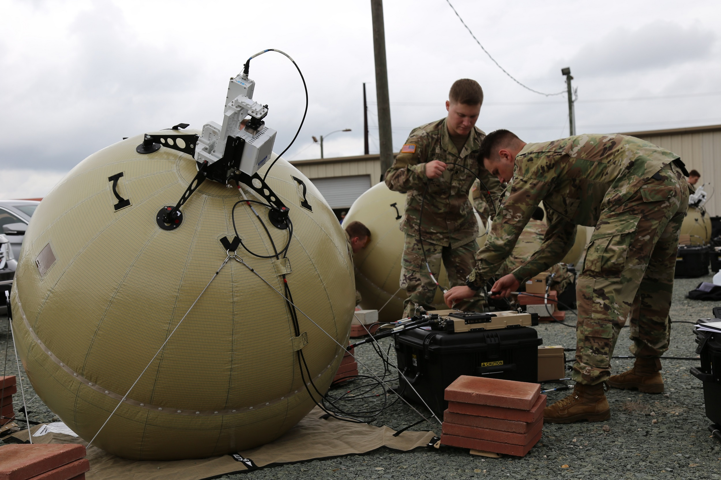 In support of initial entry and other tactical edge missions, PM Tactical Network/PEO C3T equipped the first unit -- the 3rd Brigade Combat Team, 82nd Airborne Division -- with the new inflatable satellite communications system known as Transportable Tactical Command Communications, or T2C2, to enable expeditionary mission command and situational awareness in the heart of evolving fights. (U.S. Army photo by Amy Walker, February 21, 2018 )