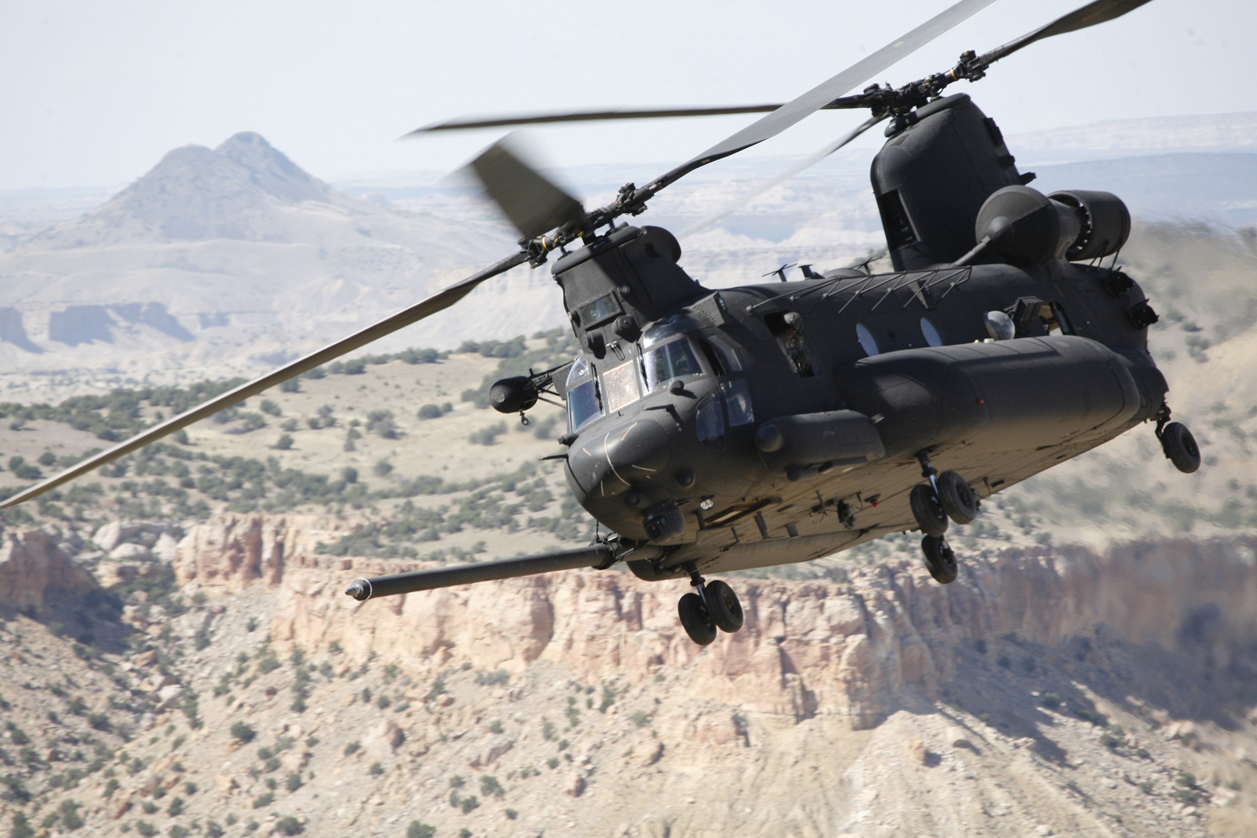 This MH-47 Chinook is an Army helicopter that has been modified for SOF missions. SOCOM's programs are predominately ACAT III, thereby minimizing statutory requirements and layered oversight. ACAT I platforms such as the Chinook, as well as gunships and maritime vessels, are provided by the services, then modified by SOF AT&L for specific mission requirements. (Photo courtesy of SOF AT&L)