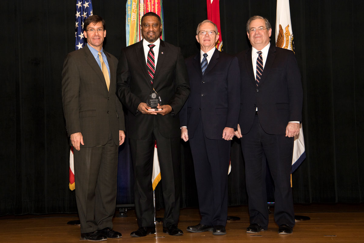 Billy McCain receives the 2017 Army Acquisition Executive's Excellence in Leadership Logistician of the Year Award in January at the Pentagon. From left are Dr. Mark T. Esper, secretary of the Army; McCain; Dr. Bruce D. Jette, assistant secretary of the Army for acquisition, logistics and technology (ASA(ALT)) and the Army acquisition exeutive; and Jeffrey S. White, principal deputy to the ASA(ALT). (U.S. Army photo)