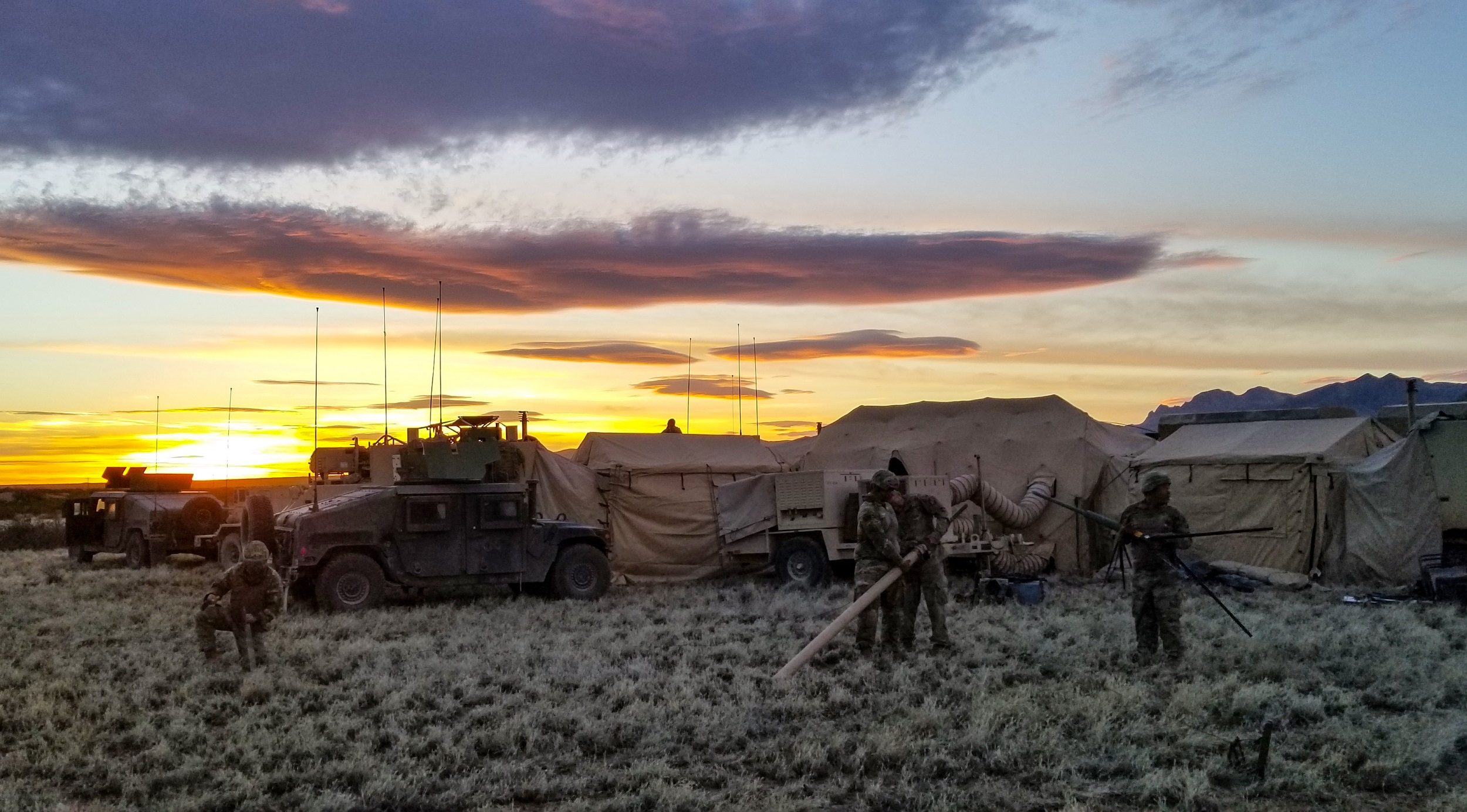 Soldiers assigned to Headquarters Company, 1st Battalion, 155th Infantry Regiment, work to establish communications during a field training exercise near Camp McGregor, N.M., April 6, 2018. (U.S. Army National Guard photo by Sgt. Timothy Russell)