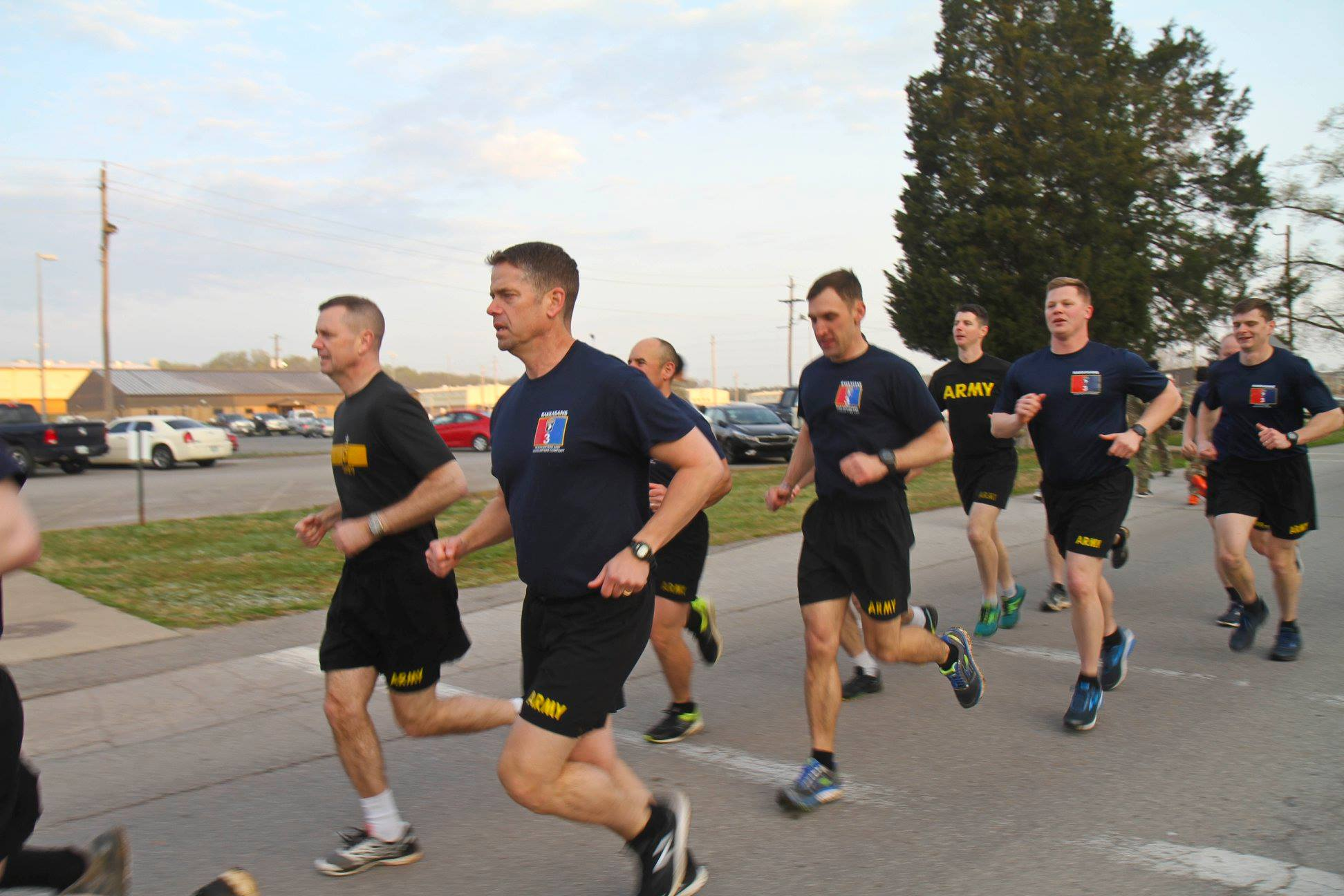 Col. John Cogbill conducts physical training with Brig. Gen. K.