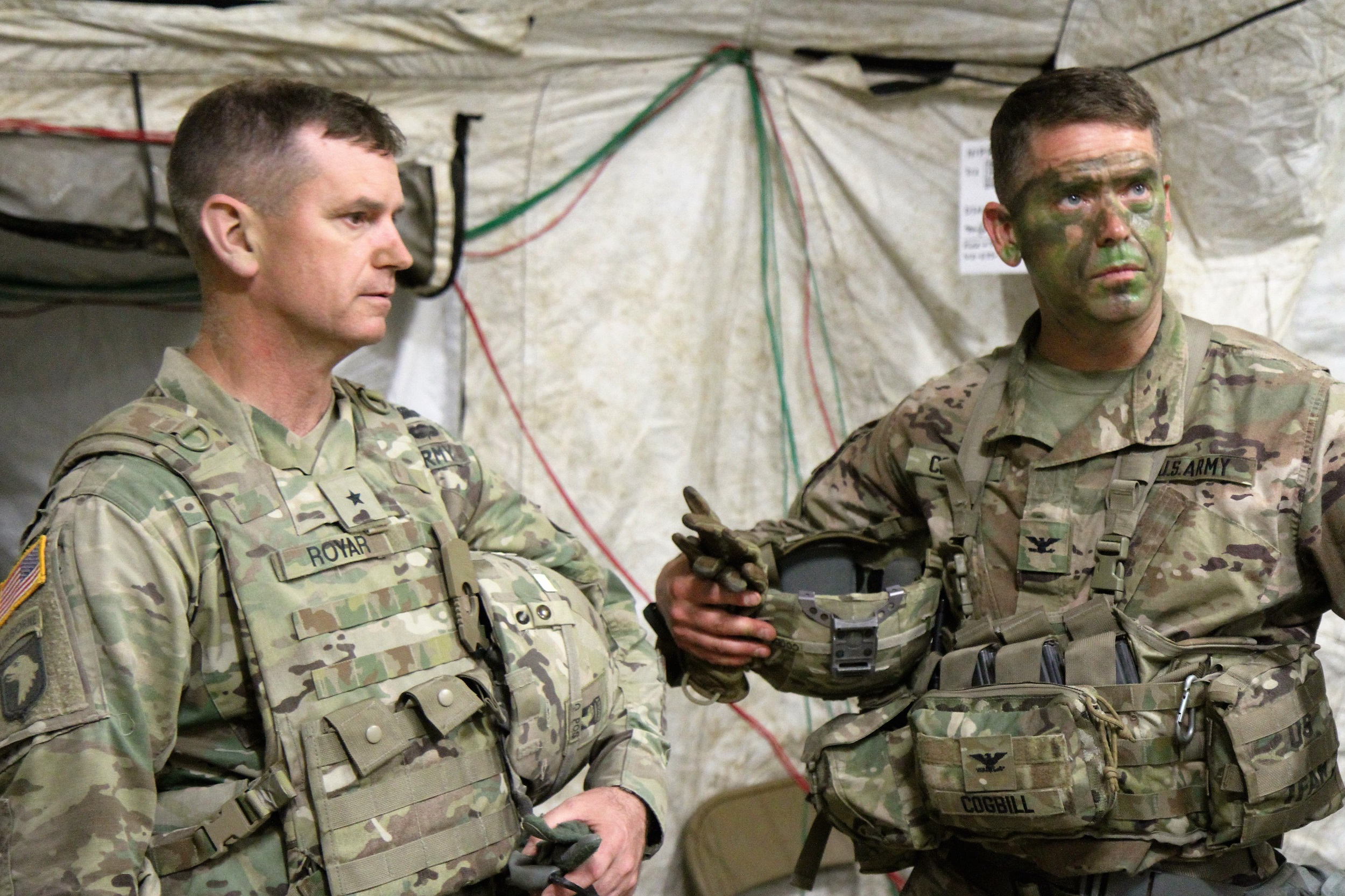 Col. John Cogbill (right) and Brig. Gen. K. Todd Royar, the 101st Airborne Division Deputy Commanding General, Support, discuss 3BCT training inside the 3BCT Tactical Operations Center (TOC). The TOC is the location where the 3BCT Headquarters and Staff conduct battle tracking and mission planning when deployed during training events and tactical operations. (U.S. Army Photo by Staff Sgt. Cody Harding - taken May 10, 2018).