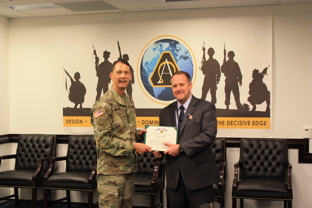 Warner receives the Achievement Medal for Civilian Service May 3, 2018, from Brig. Gen. Robert Marion, deputy for acquisition and systems management within ASA(ALT). Photo by Maj. Thomas Kralyn, ASA(ALT) Acquisition Reporting and Assessments Office