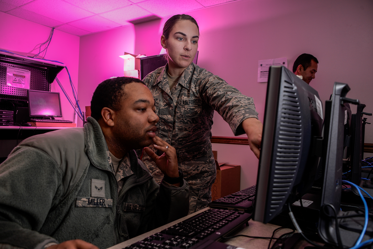 Airman 1st Class Tevin Miller and Airman 1st Class Amanda Button, 707th Communications Squadron client system technicians, update software for computers that will be used on Air Force networks in January at Fort Meade, Maryland. Joint forces, coordinating from command centers to the warfighter in the field, will use integrated software systems that allow for early warning and situational understanding. The Analytical Framework's goal is to get capabilities like these into the hands of warfighters sooner. (U.S. Air Force photo by Staff Sgt. ¬Alexandre Montes, 70th Intelligence, Surveillance and Reconnaissance Wing)