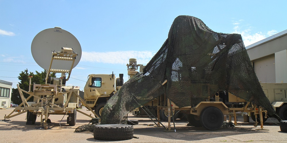 A Satellite Transportable Terminal covered in camouflage netting is being tested for CERDEC, the result of two factors: the 3rd BCT's emphasis on embracing innovation and a partnership that developed when the 3rd BCT reached out to other organizations in an effort to develop a more agile expeditionary command post. (U.S. Army photo by Staff Sgt. Cody Harding, 3/101)