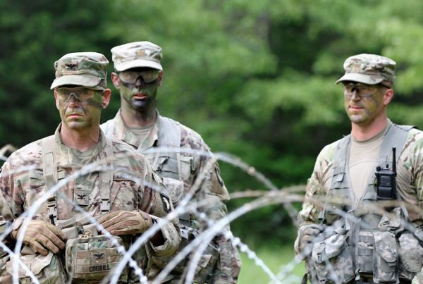 Cogbill, left, along with Maj. Joshua Glonek, right, the 3rd BCT's operations and training officer, and Maj. Ross Pixler, the operations and training officer of the 3rd Battalion, 187th Infantry Regiment, observe and evaluate company commanders during an exercise in May. The blank-fire exercise tested the companies' abilities to collectively maneuver on and destroy an enemy force in a simulated combat mission. To ensure overmatch in any battle, Cogbill and the entire BCT have adopted a do-it-yourself approach to making sure the unit has the capabilities it needs. (U.S. Army photo by Staff Sgt. Cody Harding, 3/101)