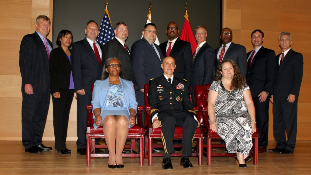 Lareina Adams, second from left, poses with other graduates, instructors and guests during Defense Acquisition University's Senior Service College Fellowship Program graduation on May 23, 2017. Adams is currently serving as the product lead for the Headquarters Army Environmental System, PM GFEBS, at PEO EIS. She will take on her new role as product manager for Counter Explosive Hazard at PEO IEW&S in the summer of 2019. (Photo courtesy of Lareina Adams)