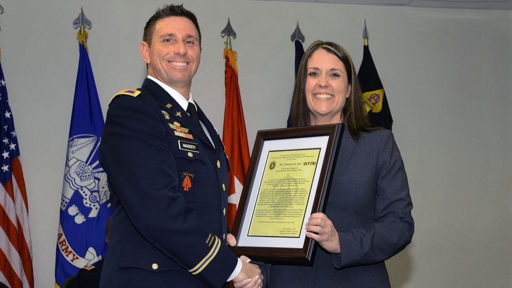 Christina M. Bell, with Col. Rich Haggerty during a change of charter ceremony, officially assumed her role as product manager for Special Operations Forces Training Systems at PEO STRI in June, where she hopes to continue to enable readiness for the warfighter in the special operations forces community. (Photo courtesy of Christina Bell)
