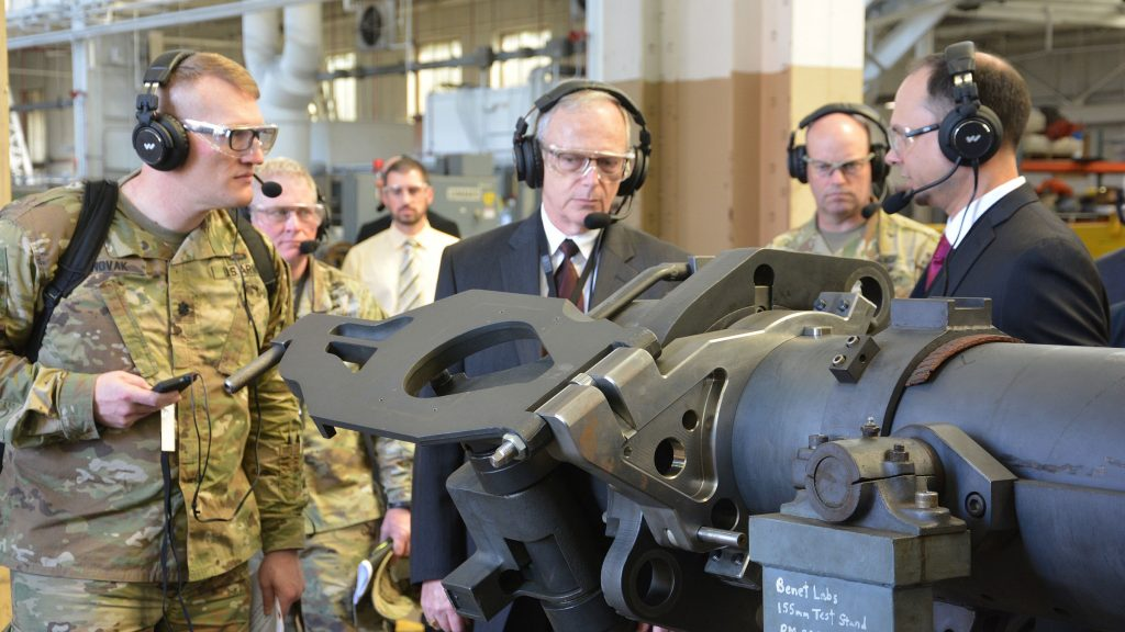 Jette, center, and Lt. Col. Joseph Novak, left, receive a briefing from Nathaniel Klein, right, of Army Benét Laboratories about product improvements for cannon systems on May 8 at Watervliet Arsenal, New York. Novak is with the Program Executive Office for Ground Combat Systems. (Photo by John Snyder, Watervliet Arsenal)