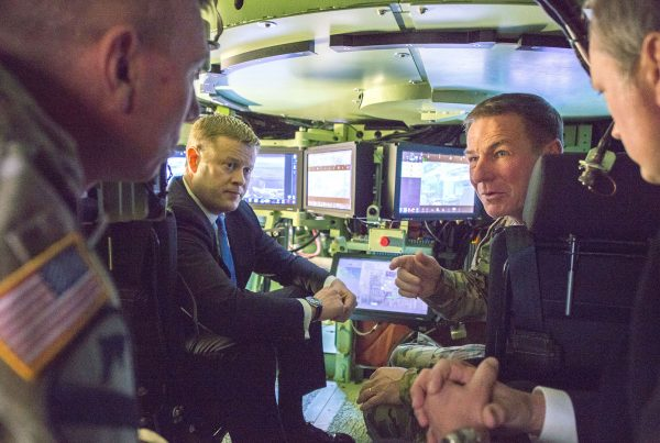 Undersecretary of the Army Ryan D. McCarthy, center left, and Gen. James C. McConville, the Army's vice chief of staff, center right, discuss emerging technology while inside the Mission Enabling Technologies – Demonstrator, a modified Bradley Fighting Vehicle equipped with several upgrades, during a tour Jan. 18 of the Army's Tank Automotive Research, Development and Engineering Center at the Detroit Arsenal in Michigan. RCO has pointed the way to getting new capabilities rapidly into the hands of deployed Soldiers. (U.S. Army photo by Sean Kimmons, Defense Media Activity – Army)