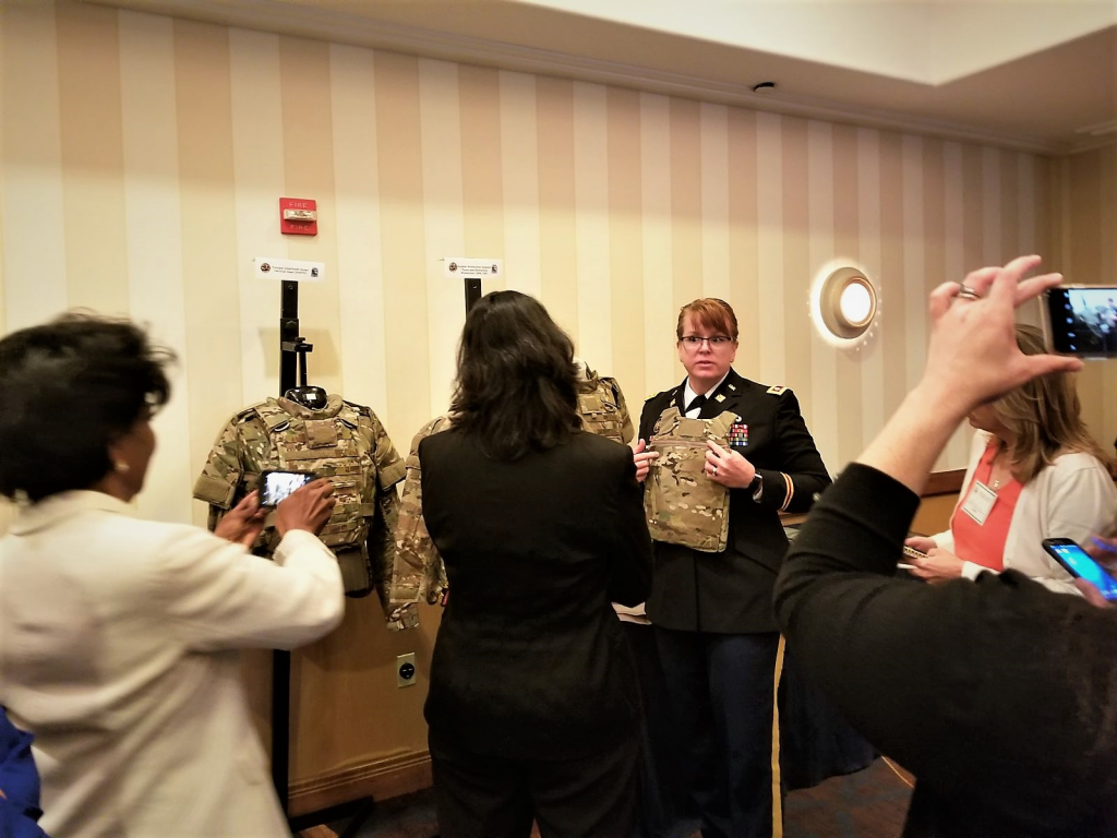 Lt. Col. Ginger Whitehead, product manager for Soldier Protection and Individual Equipment of PEO Soldier, shows members of the Defense Advisory Committee on Women Services' the new, female-specific body armor from the Soldier Protection System. This body armor provides better fit and function to female Soldiers. (U.S. Army photo by Debra Dawson, PEO Soldier)