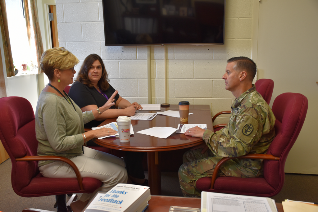 Bailey Berst Parker meeting: USAMMDA commander Col. Ryan Bailey (right) meets with Kathleen Berst, USAMMDA deputy for acquisition (center), and Christine Parker, acting project manager for USAMMDAs Medical Devices--Advanced Development Project Management Office. (Photo by Ashley Force, USAMMDA public affairs) DATE: July 20, 2018.