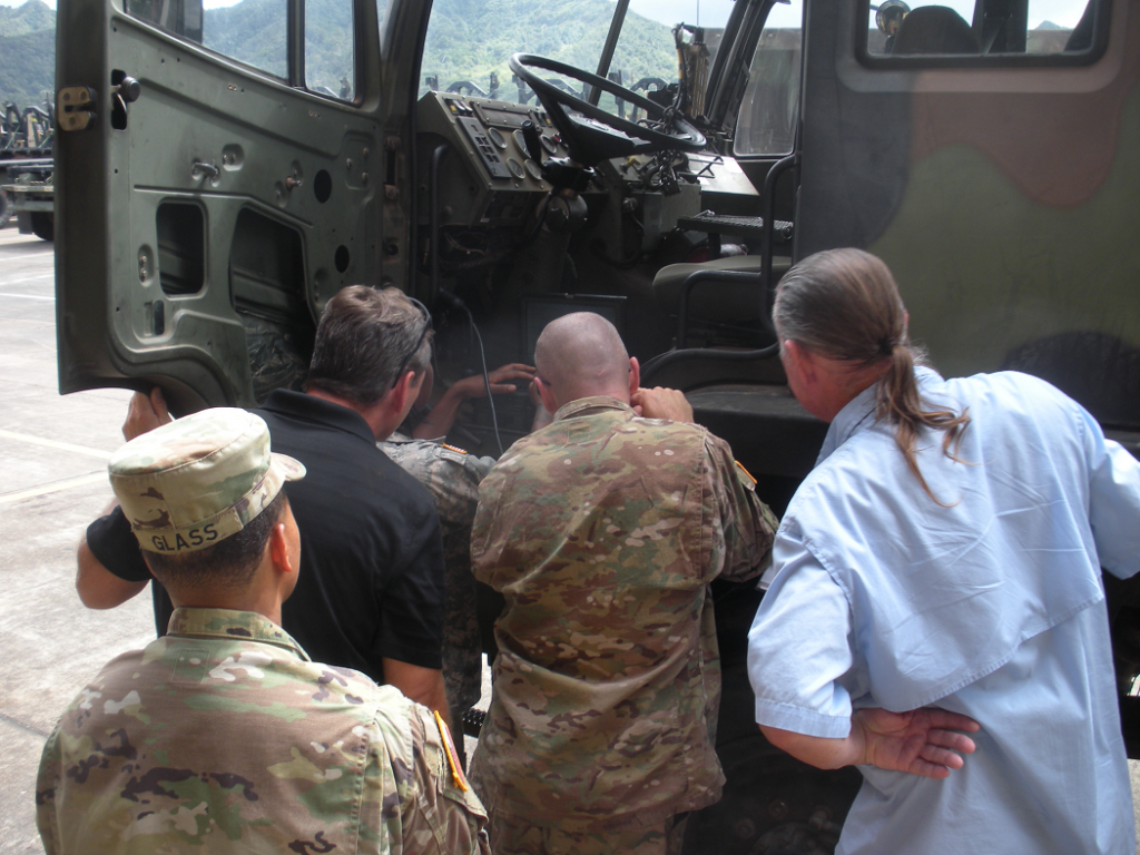 Soldiers from 25th Transportation Company receiving hands-on diagnostics training on M1083 FMTV from AMSAA CBM analysts, Schofield Barracks, HI, August 2016. Photo by Mr. Jesse Fields, AMSAA Operational Sustainment Analysis Team.