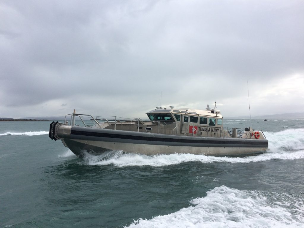 """A Tunisian navy 65-foot Archangel Patrol boat is underway near the Tunisian navy base in Bizerte. The security cooperation relationship between the Tunisian government and the United States exemplifies one of the major purposes of U.S. security cooperation efforts: to """"develop allied and friendly military capabilities for self-defense and multinational operations."""" (Photo courtesy of U.S. Embassy Tunis)"""