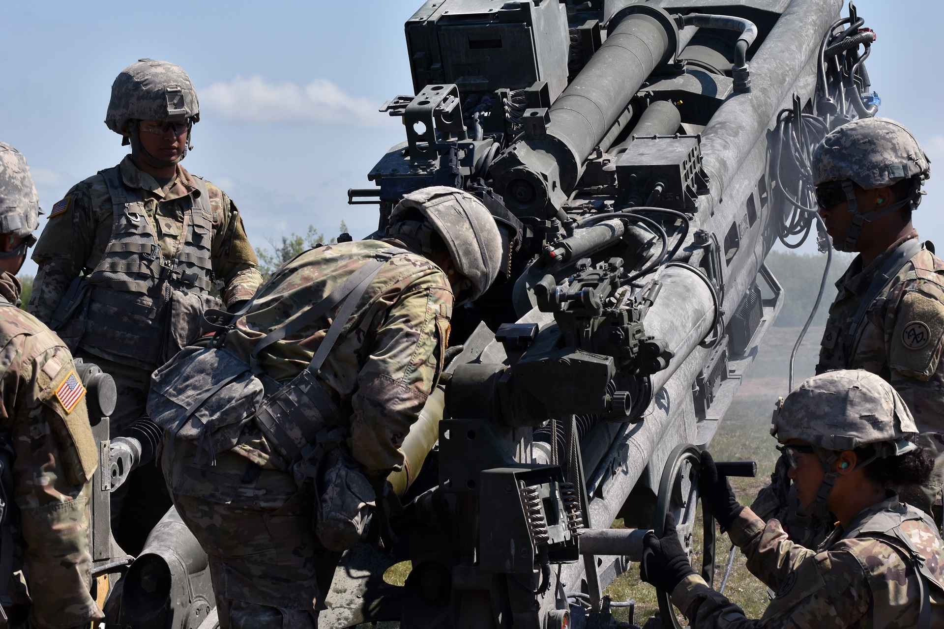 New York National Guard Soldiers assigned to Charlie Battery, 1st Battalion, 258th Field Artillery, load a round into a M777 Howitzer, on Fort Drum, Watertown N.Y., May 22nd, 2018. Soldiers from the 258 spent the past two weeks preparing to fire these weapons, which are much larger, and more powerful than the previous cannon's they used. (N.Y. Army National Guard photo by Spc. Andrew Valenza)