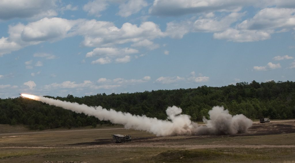 Gun crews of Battery B, 1st Battalion, 147th Field Artillery Regiment, Yankton, S.D., fire their Multiple Launch Rocket System at Camp Grayling, Mich., Aug. 10, 2018. South Dakota Army National Guard Soldiers are participating in Northern Strike, a joint multinational combined arms live fire exercise involving approximately 5,000 service members from 11 states and six coalition countries. (U.S. Army National Guard photo by Spc. Joshua Boisvert)