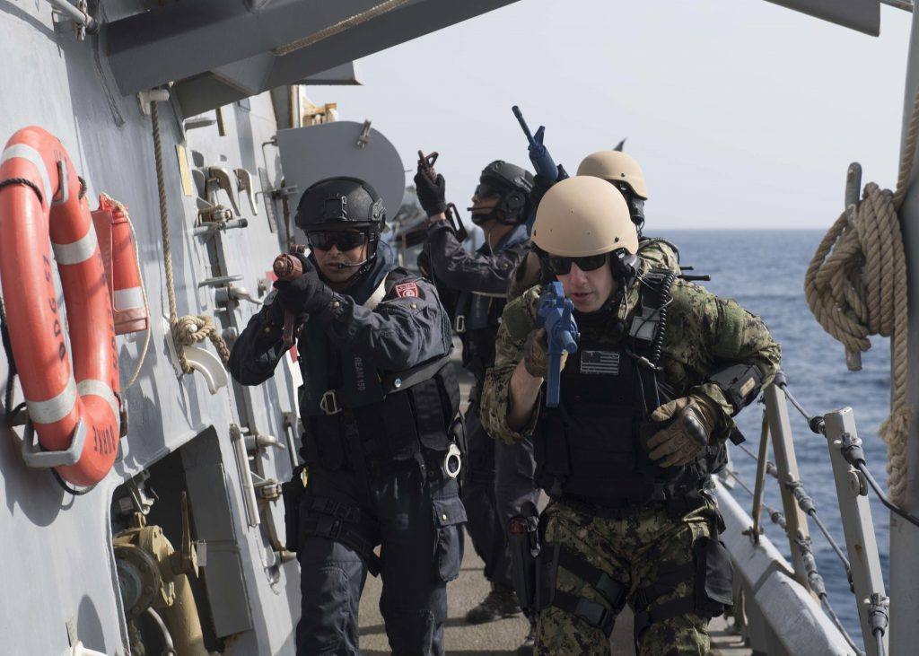 Sailors from Tunisia and the guided-missile destroyer USS Arleigh Burke (DDG 51) simulate clearing a ship during a training exercise on April 25. The Tunisian navy operates with a level of professionalism that equals its European partners, and most of its officers supplement their training with developmental opportunities with navies and industry partners around the world. (U.S. Navy photo by Mass Communication Specialist Seaman Raymond Maddocks)