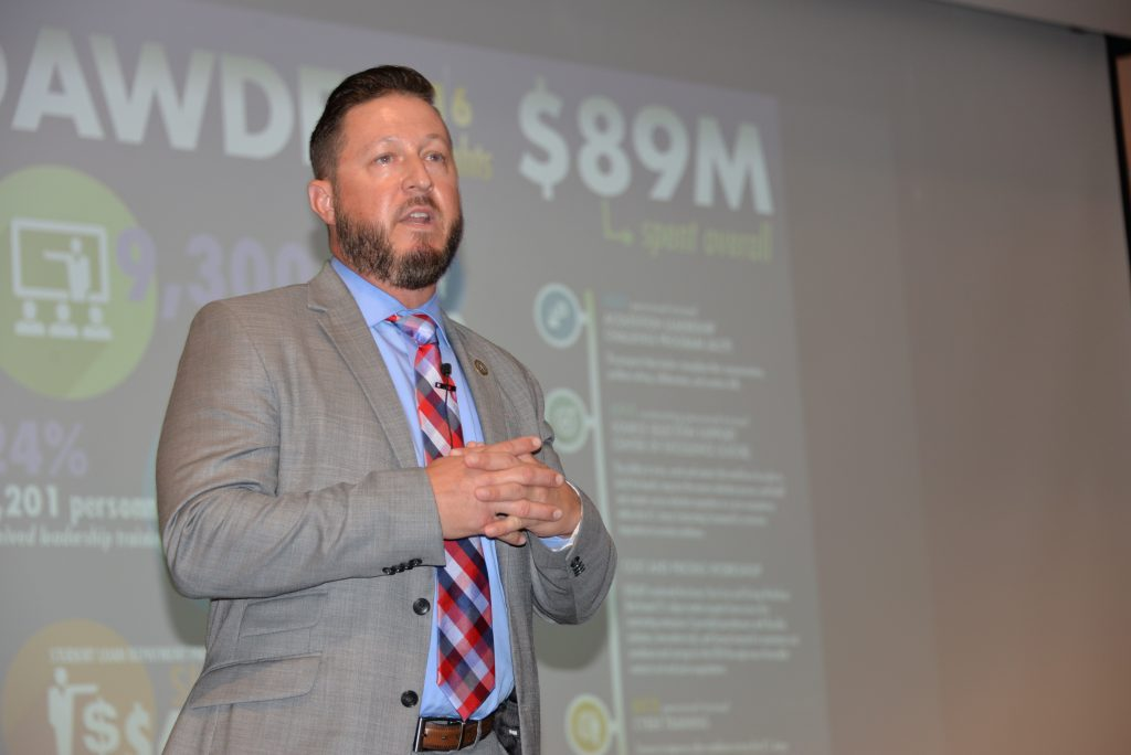 Jason Pitts, chief of the Acquisition Functional Integration Branch at the DACM Office, presents DAWDF financial data to a group of acquisition professionals during the Back to Basics developmental conference in September 2017. DAWDF helps facilitate temporary rotations in other organizations, as well as education and training assignments, to broaden workforce experience. (U.S. Army photo)