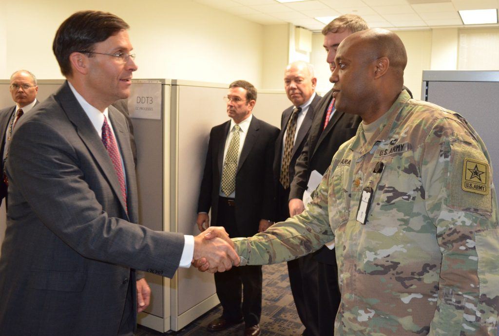 Kamara meets Secretary of the Army Mark T. Esper during Esper's visit to the Army Futures Command Task Force in Arlington, Virginia, in December 2017. (Photo courtesy of Army Futures Command Public Affairs