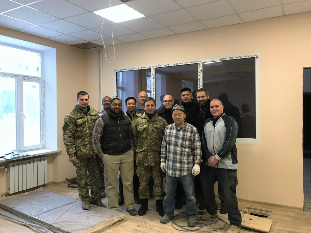 AIT, GDIT and UAF personnel gather for a photo during construction of new Ukrainian Special Operations Forces IT training center, December 2017. Photo credit: Mr. Jeremy Way, AIT support contractor