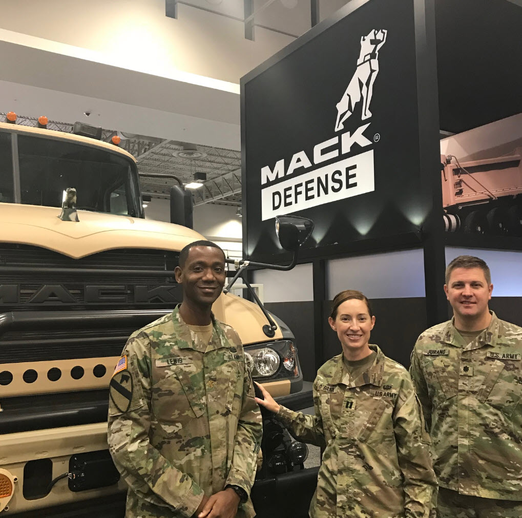 With Lt. Col. Jurand at AUSA in 2018 are Maj. Eric Lewis and then-Capt. Katie OBrien, both assistant product managers in the Product Manager for Heavy Tactical Vehicles. (Photo courtesy of Maj. Jurand and Mack Defense LLC)